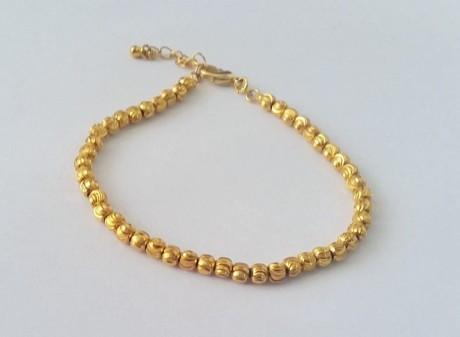 צמיד כדורי זהב